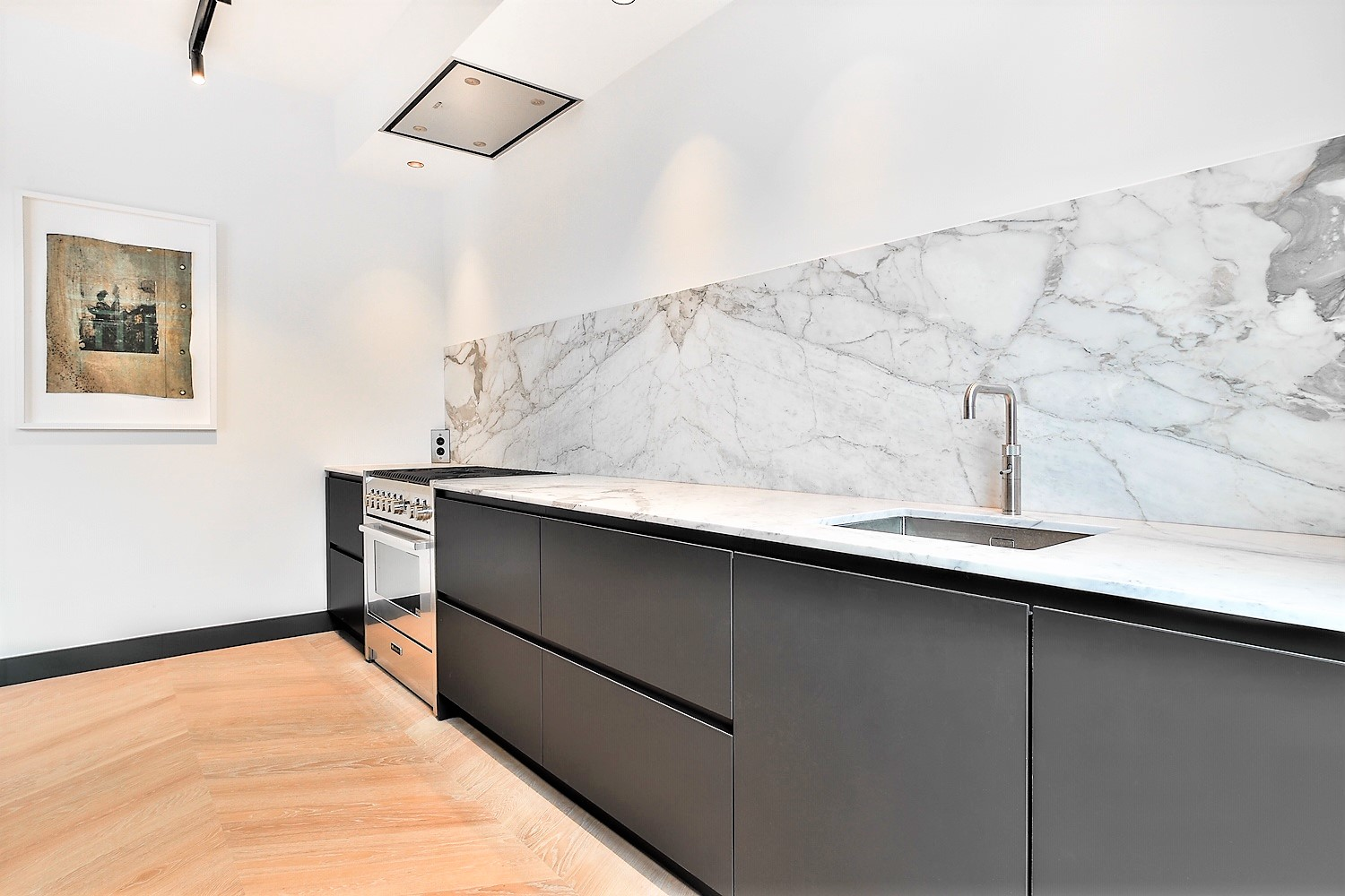 Calacatta marble kitchen in book match