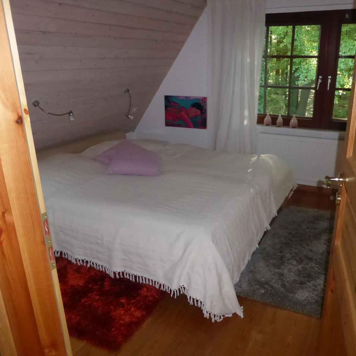 Ferienwohnung Im Waldwinkel, Schlafzimmer im Obergeschoss