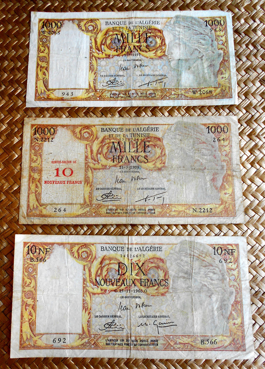 Argelia ocup.francesa 1000 francos 1957 vs. resello 10 nv. francos 1958 vs. 10 nv. francos 1960 anverso