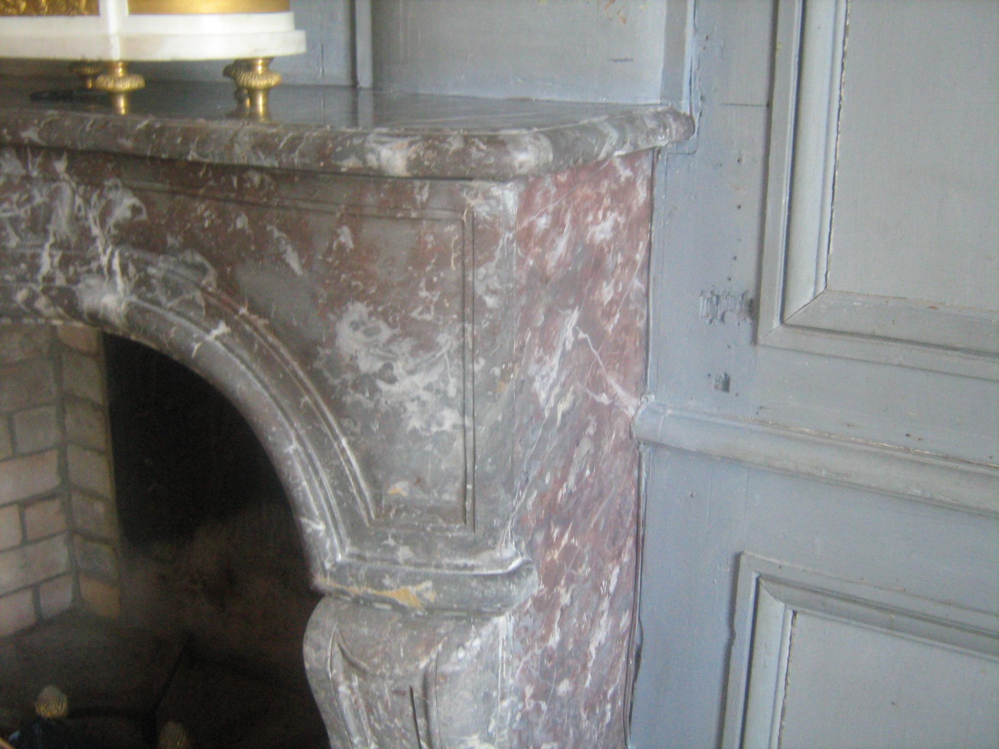 Restauration cheminée en imitation de marbre