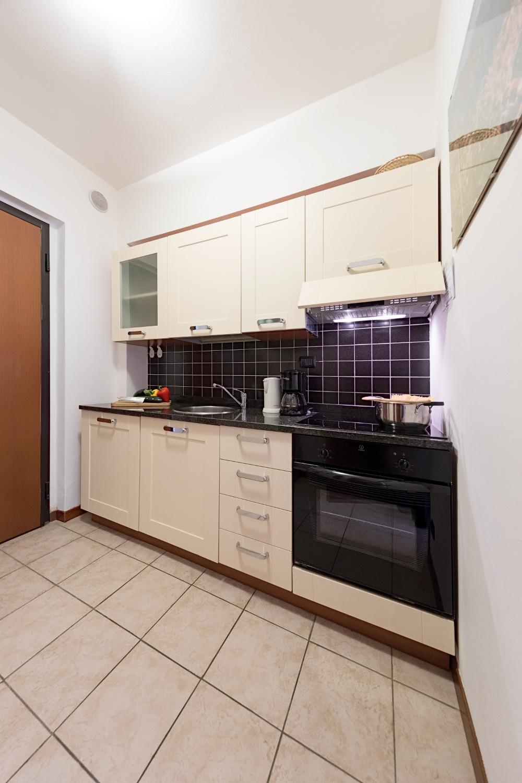 Entry door and kitchen