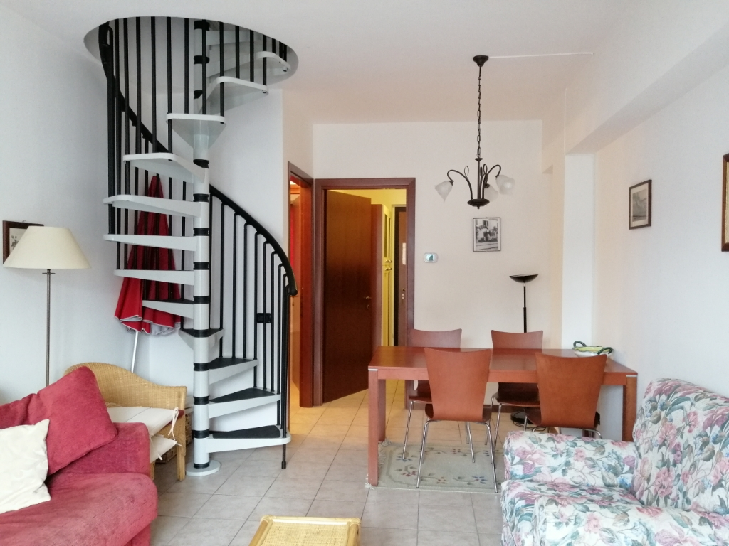Entry to the Living Room with access to the 1st Bathroom and to the Bedrooms upstairs