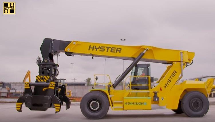 reach stacker Hyster avec pince pour lever acier
