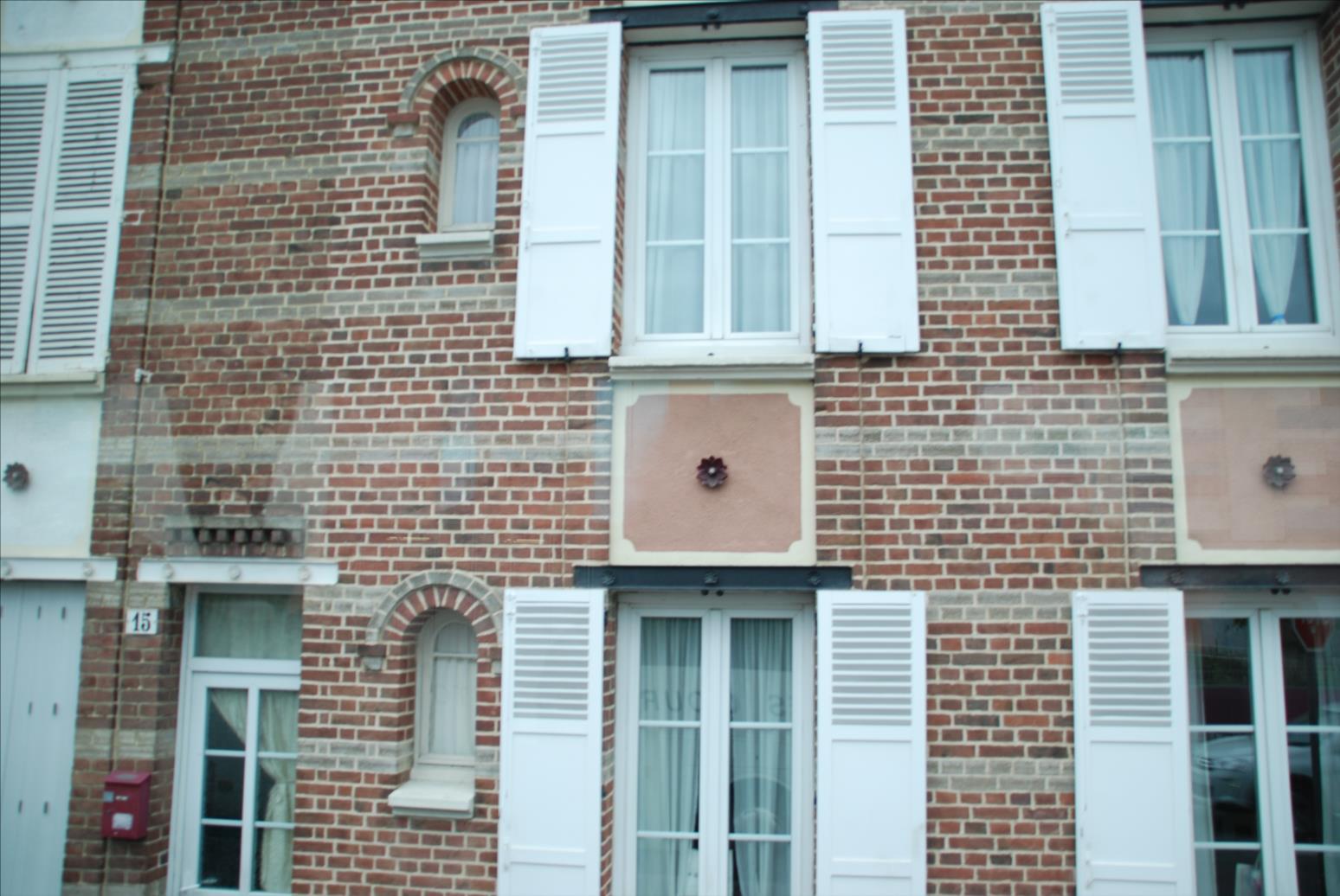 Utilisation des fleurons sur une façade