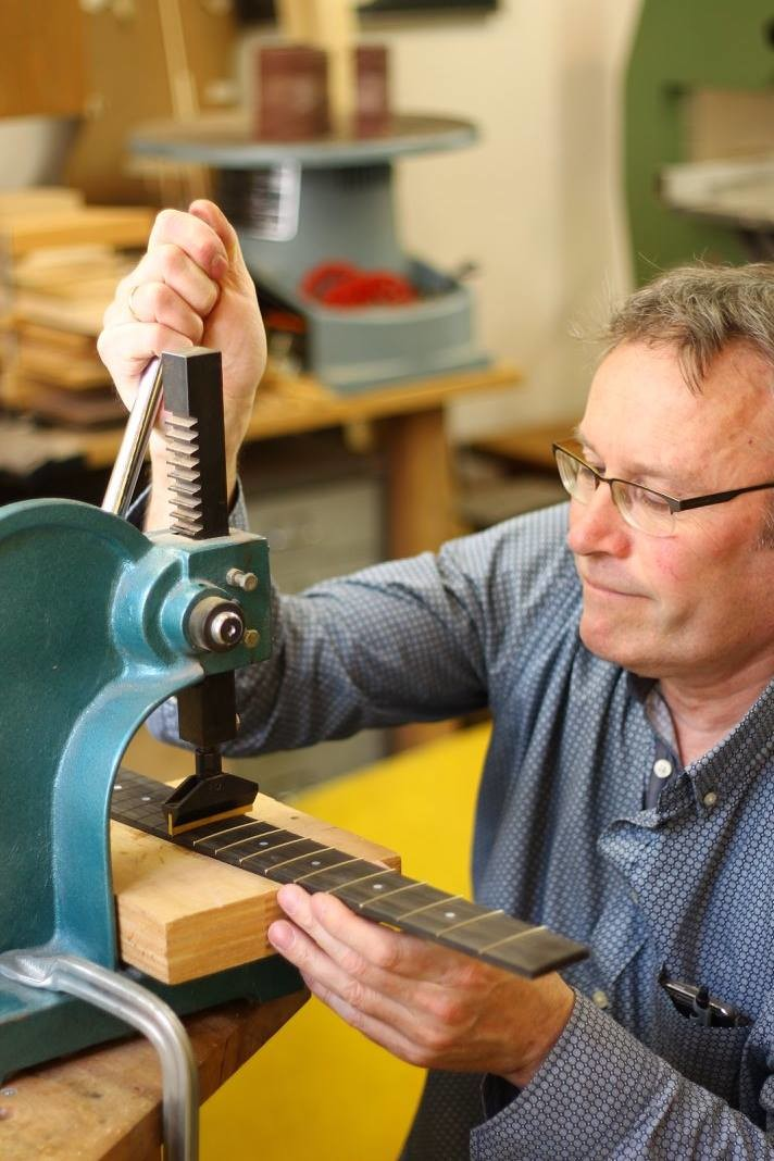 Pressing in the frets