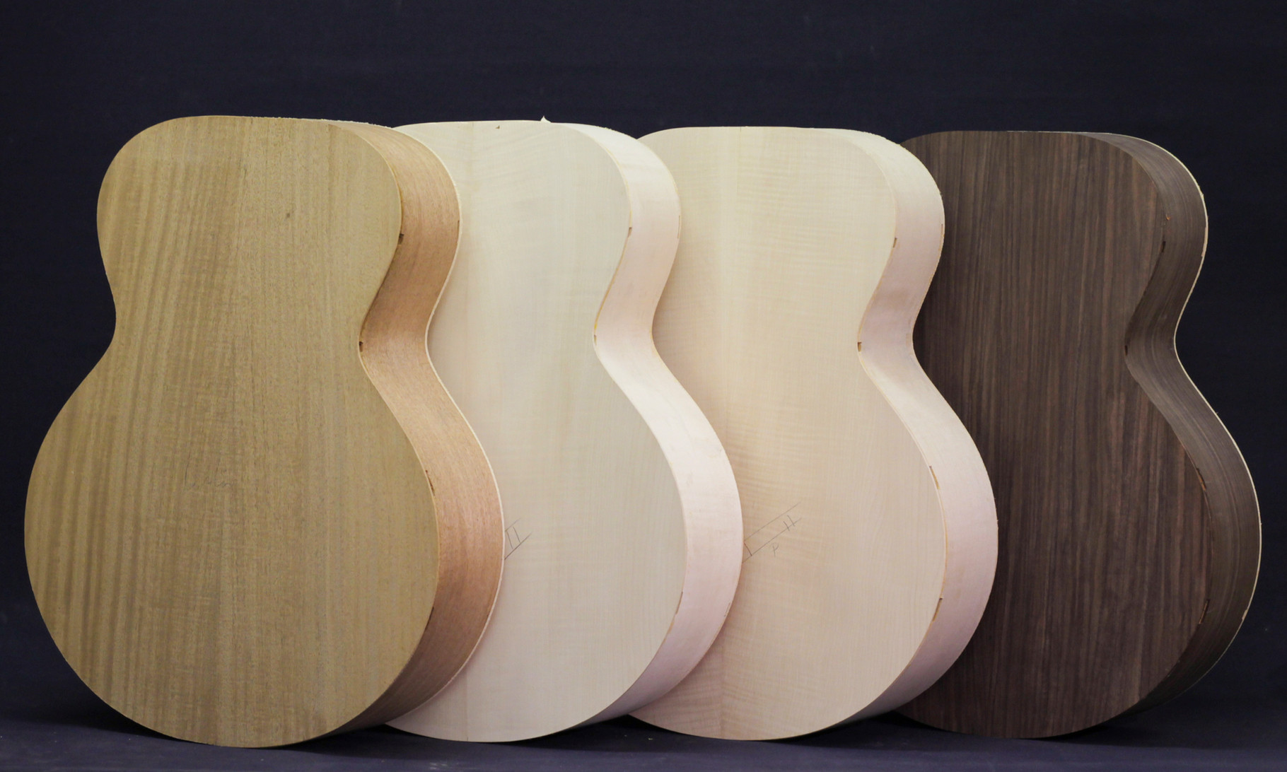 Left to right: Mahogany, Maple (I), Maple (II), Rosewood