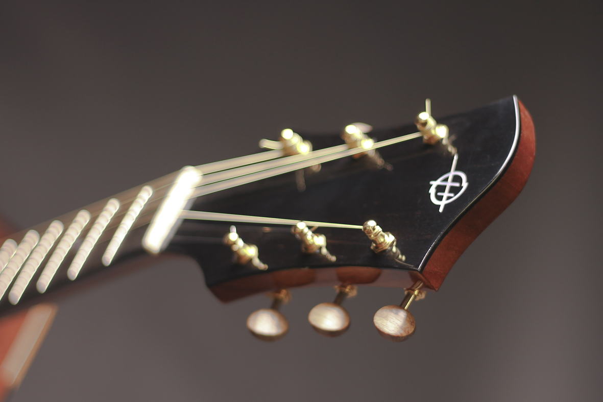 Headstock with koa tuners