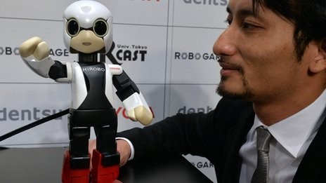 (Kirobo):Tomotaka Takahashi with his creation <From BBC-Asia>