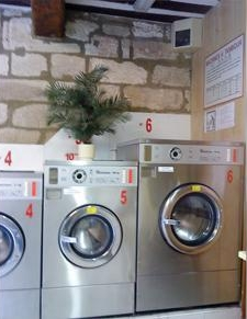 The laundress is a ironing service, and an automatic laundry area with 5 dryers, 6 washing machine