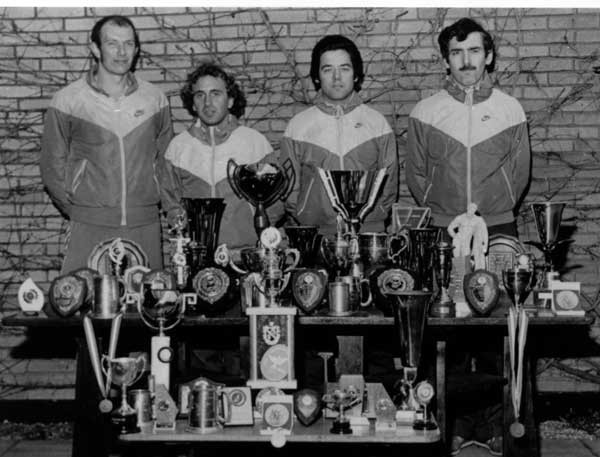 Gloucester AC team of the 1980s display their ultra distance running trophies. L to R Martin Daykin, Dave Dowdle, Ken Leyshon, Chris O'Carroll