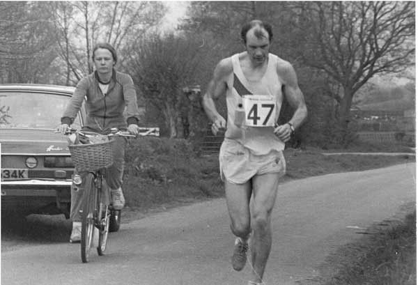 Martin Daykin in the Gloucester 100 mile race with his wife, Liz, supporting on the bicycle