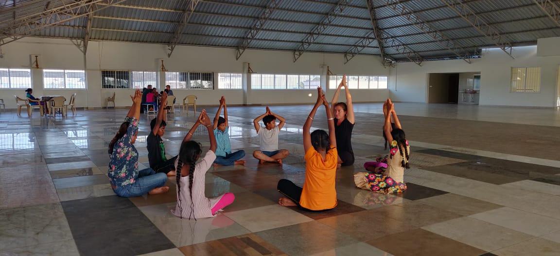 Mentor demonstrating yoga