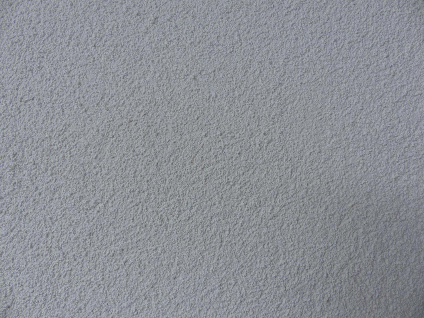 Außenputz: zweilagiges System aus Grundputz und mineralischer Oberputz