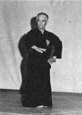 Uehara sensei demonstrating mai no te at a presentation