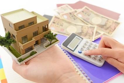 住宅模型と電卓での資金計算