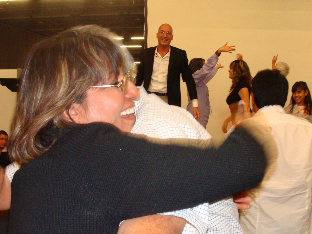 Hugging during an Emotional Managemente Seminar.