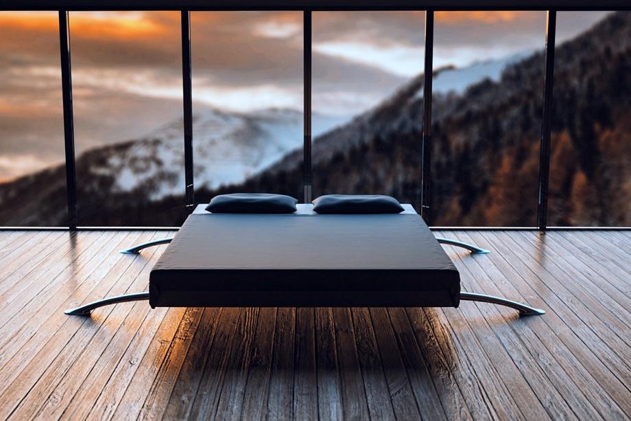 Bett in einem Raum mit Aussicht auf Berge