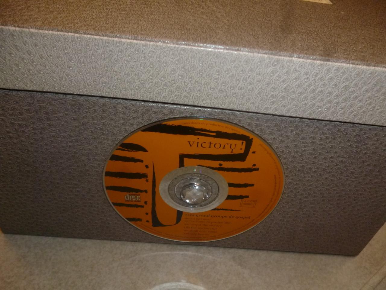 mise en place d'un petit bouton au milieu du cd
