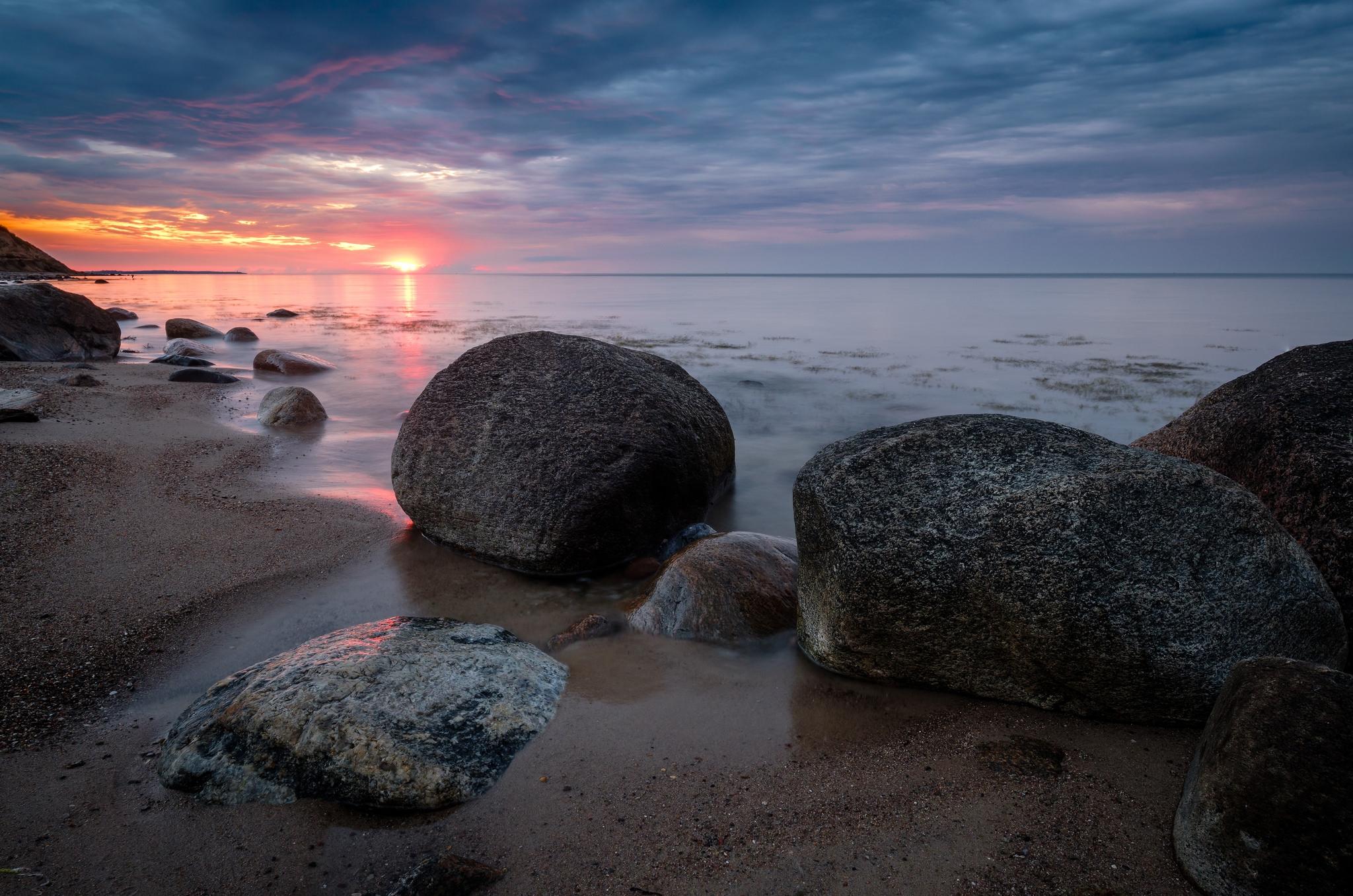 Sonnenuntergang mit versteinerten Meerjungfrauen am Weißenhäuser Strand