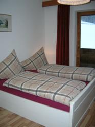 Doppelbettzimmer im Appartement Tirol