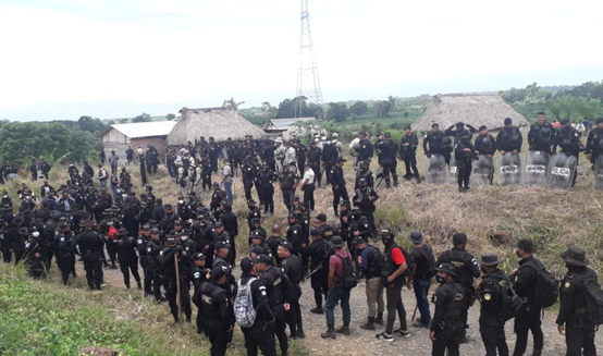Photo 2: large deployment of anti-protest police force near El Estor, Izabal, following a martial law declaration – illegal since it was not validated by the Congress. Source: Twitter / CUCGuatemala, July 29, 2020
