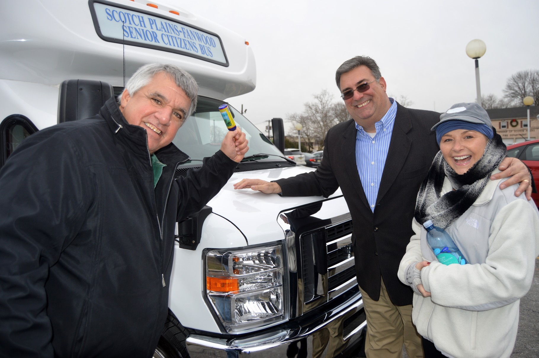 Mayor Glover christens the new bus with Township Manager Al Mirabella and Deputy Mayor Rose Checchio