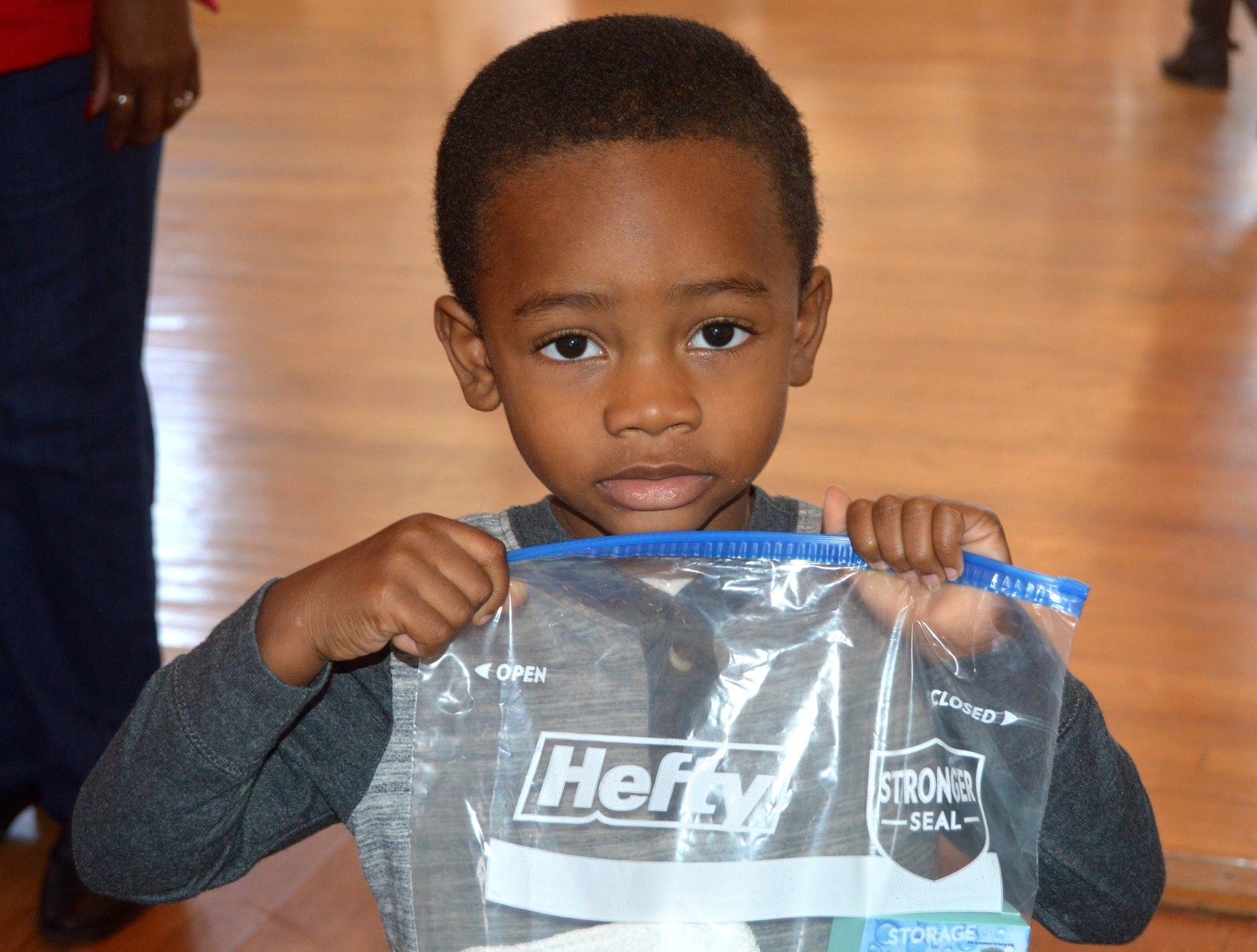 Children helped prepare health kit bags