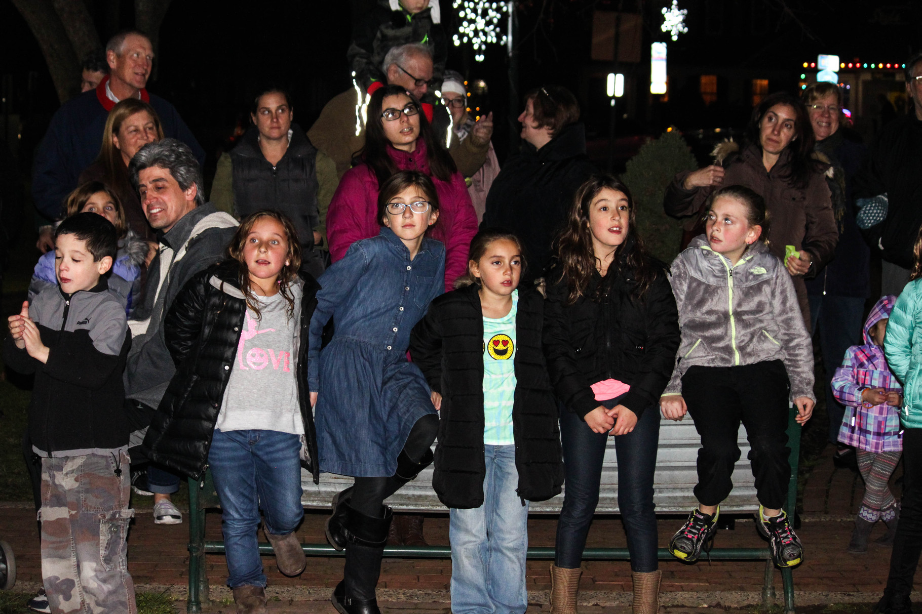 Children await the singing of traditional Hanukkah songs