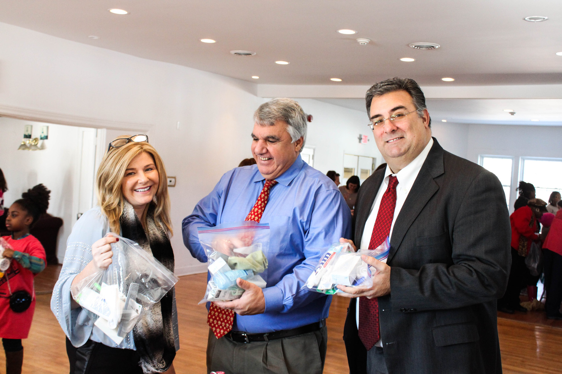 Deputy Mayor Rose Checchio, Mayor Kevin Glover, and Township Manager Al Mirabella display their finalized health kits at Scotch Hills Country Club