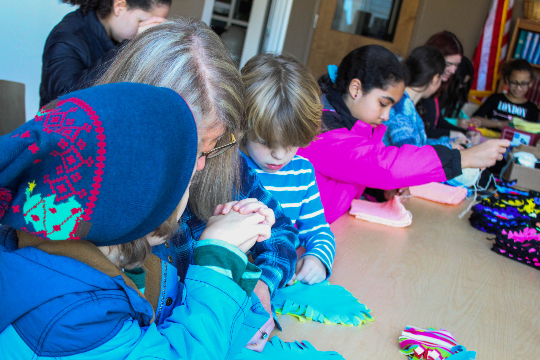 Kids learn how to crochet at Temple Sholom