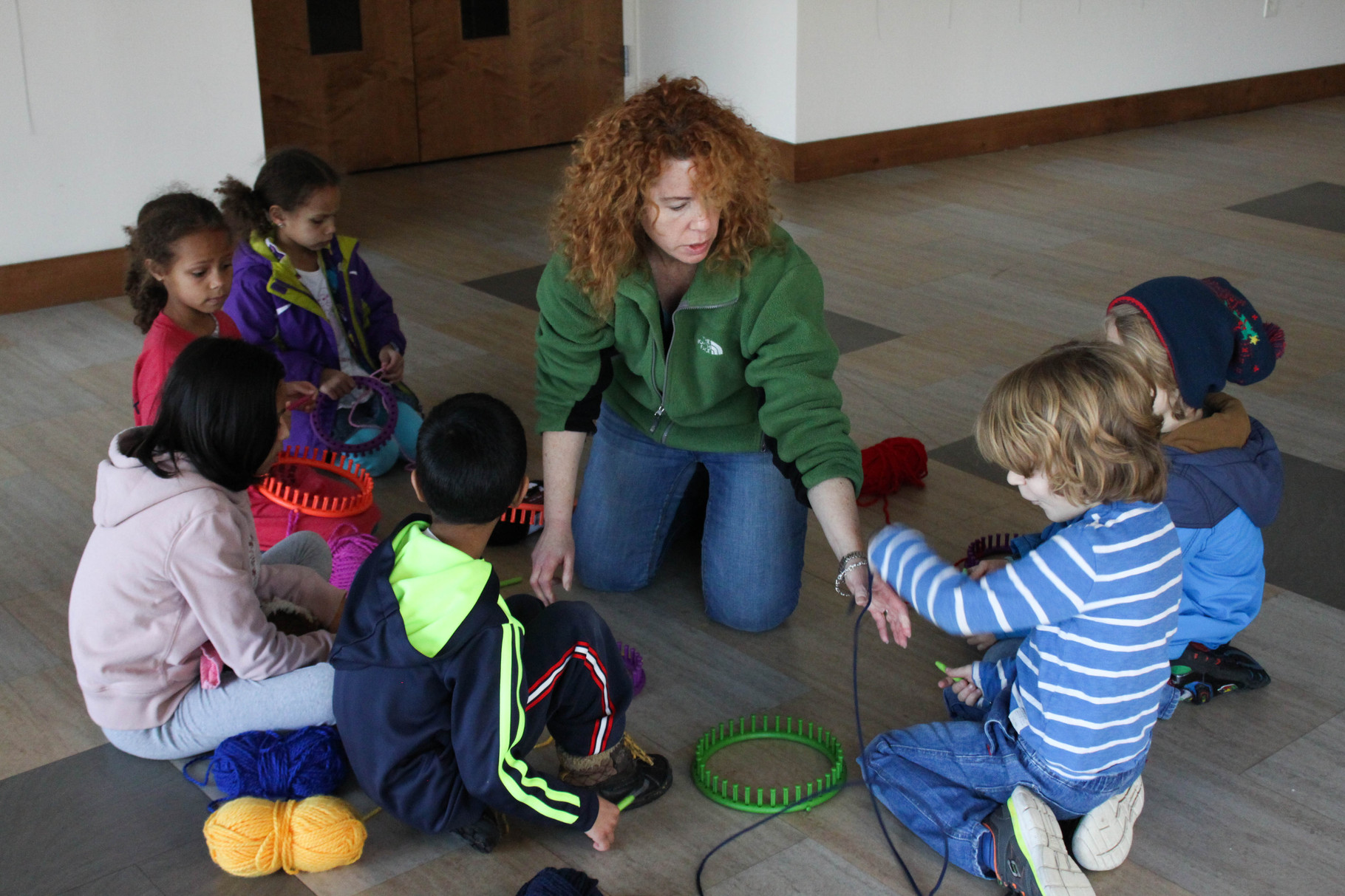 Donna Teschner shows children how to knit hats