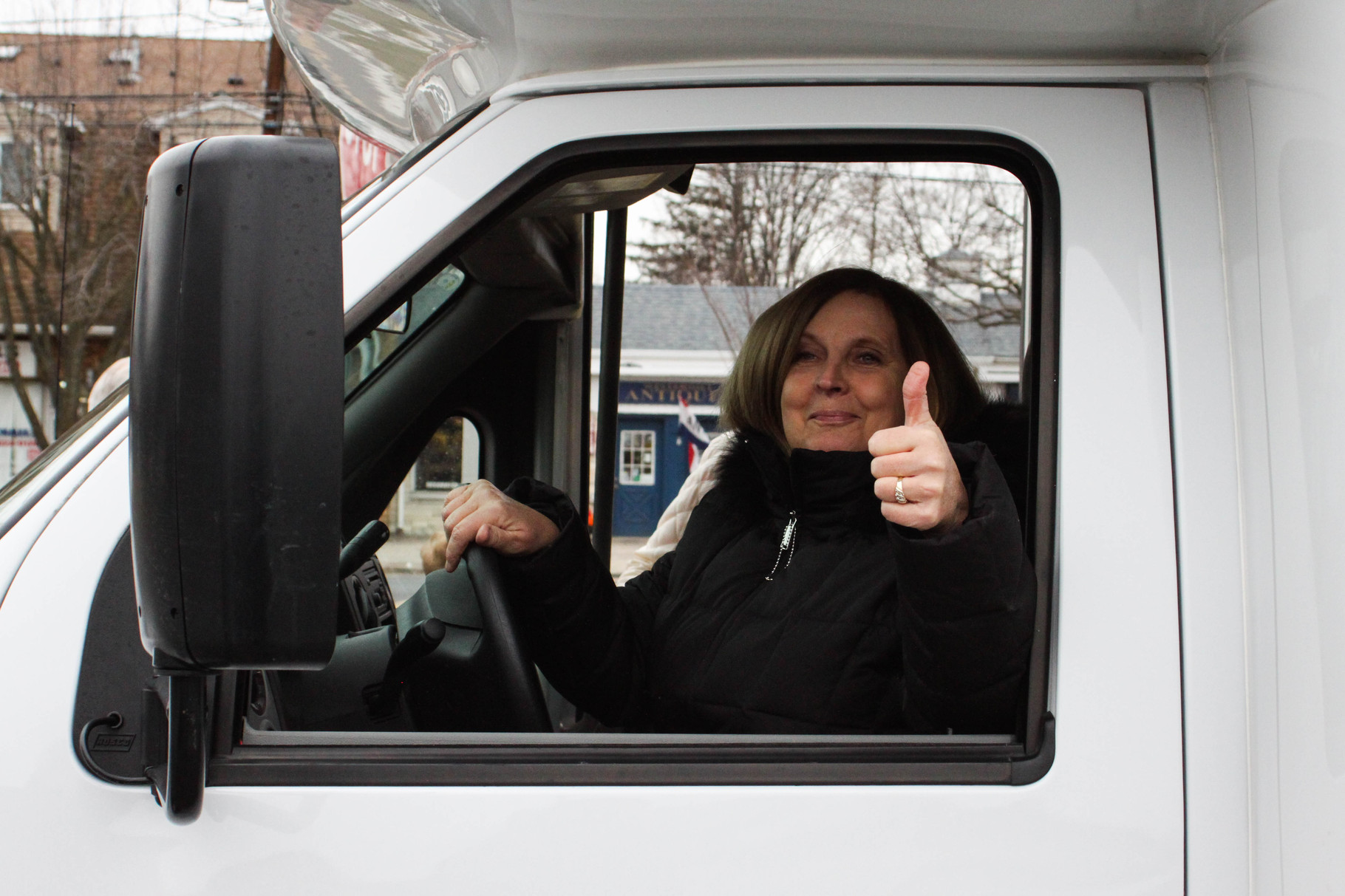 Bus driver Lynn Barattuci gives a thumbs up before the bus's inaugural ride