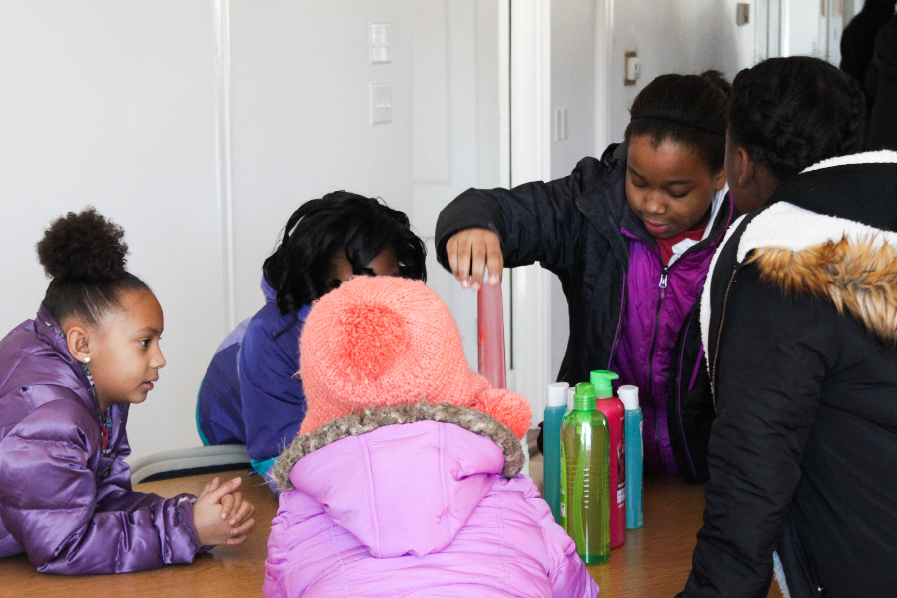 Children help sort out the items included in the health kits