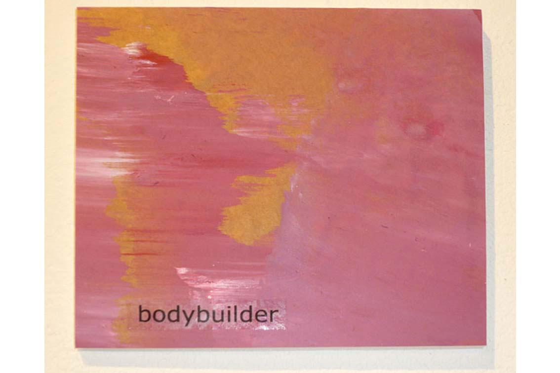 OK – bodybuilder, Zeichnung auf Papier, mit Begriffen auf Klebeband und Papier, auf einer Platte befestigt, ICW und Leslie Fry, 2009