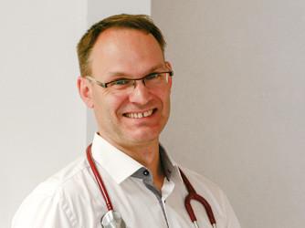 DR. ULRICH TAUSCH
